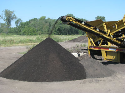 Black topsoil being screened